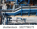 steel pipes at the plant for... | Shutterstock . vector #1027758175