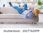 funny man singing songs in... | Shutterstock . vector #1027762099