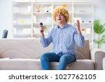 funny man singing songs in... | Shutterstock . vector #1027762105