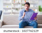funny man singing songs in... | Shutterstock . vector #1027762129