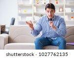 funny man singing songs in... | Shutterstock . vector #1027762135