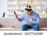funny man singing songs in... | Shutterstock . vector #1027762489