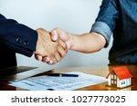customers agree to buy a house... | Shutterstock . vector #1027773025