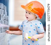 portrait of cute little builder ... | Shutterstock . vector #1027775479