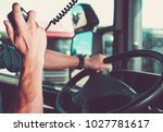 truck driving and radio chat... | Shutterstock . vector #1027781617