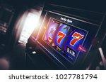 casino slot machine 3d rendered ... | Shutterstock . vector #1027781794
