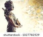 bronze statue of fortune  the... | Shutterstock . vector #1027782529