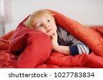 cute little boy in pajamas... | Shutterstock . vector #1027783834