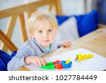 creative boy playing with... | Shutterstock . vector #1027784449