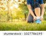 athlete woman tying running...   Shutterstock . vector #1027786195