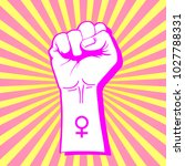 female symbol with a raised... | Shutterstock .eps vector #1027788331