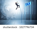businessman jumping over tax in ... | Shutterstock . vector #1027796734