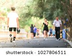 blurred background of people... | Shutterstock . vector #1027806511