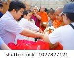people put food offerings in a... | Shutterstock . vector #1027827121
