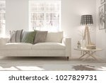 white room with sofa and winter ... | Shutterstock . vector #1027829731