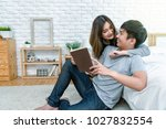 happy asian couple reading the... | Shutterstock . vector #1027832554