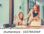 business women talking to each... | Shutterstock . vector #1027842469