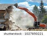 industrial excavator working at ... | Shutterstock . vector #1027850221