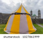 a large tent on a green lawn. | Shutterstock . vector #1027861999