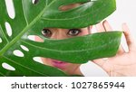 woman with green leaf. isolated ...   Shutterstock . vector #1027865944