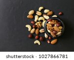 nuts mix for a healthy diet ... | Shutterstock . vector #1027866781