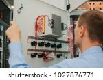 electrician specialist checking ... | Shutterstock . vector #1027876771