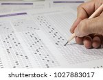 students hand doing exams quiz... | Shutterstock . vector #1027883017