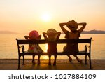 family with children sitting on ... | Shutterstock . vector #1027884109