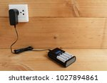 battery charger with battery... | Shutterstock . vector #1027894861