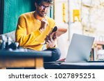 concentrated young man blogger... | Shutterstock . vector #1027895251