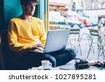 smiling hipster guy chatting... | Shutterstock . vector #1027895281