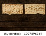 two pieces of matzah or matza... | Shutterstock . vector #1027896364