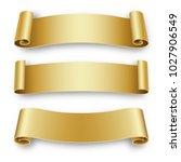 three holiday golden ribbons... | Shutterstock .eps vector #1027906549