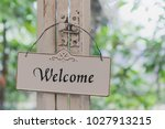 """white metal sign """"welcome""""... 