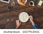 man eating cottage cheese  top... | Shutterstock . vector #1027913431