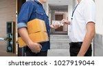 man hand holds american dollar... | Shutterstock . vector #1027919044