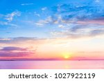 glowing paradise sunset over... | Shutterstock . vector #1027922119