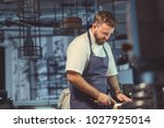 young chef in the kitchen | Shutterstock . vector #1027925014