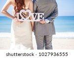 bride groom holding a love sign ... | Shutterstock . vector #1027936555