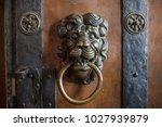 door knocker as a lion on a... | Shutterstock . vector #1027939879