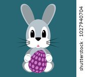 cartoon rabbit with easter egg | Shutterstock .eps vector #1027940704