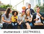 friends in the park looking... | Shutterstock . vector #1027943011