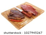 grilled and raw beef steak... | Shutterstock . vector #1027945267