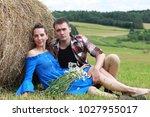 couple in love in a village... | Shutterstock . vector #1027955017