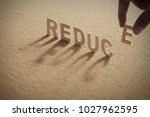 reduce wood word on compressed... | Shutterstock . vector #1027962595