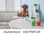 table with different baby... | Shutterstock . vector #1027969135