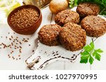 vegetarian cutlets of buckwheat ... | Shutterstock . vector #1027970995