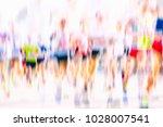 marathon runners in the city  | Shutterstock . vector #1028007541