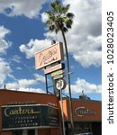 Small photo of LOS ANGELES,FEB 13th 2018: Marquee and sign of famous, historic Canter's Restaurant and Deli on Fairfax Avenue in the Fairfax District of Los Angeles, against a blue sky with white clouds and palms.