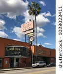 Small photo of LOS ANGELES,FEB 13th 2018: Exterior shot of the famous, historic Canter's Restaurant and Deli on Fairfax Avenue in the Fairfax District of Los Angeles, against a blue sky with white clouds and palms.